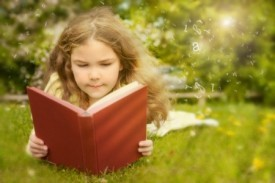 Girl reading on grass.jpeg