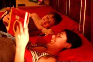 Mum and son in bed reading.jpeg