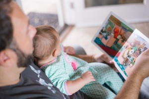dad and baby reading.jpeg